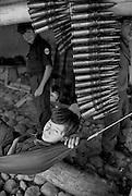 Teenage FMLN guerrillas before a patrol in El Salvador.