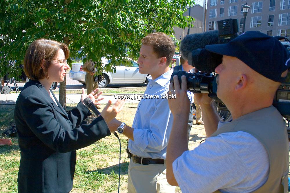 Senator Amy Klobuchar speaking to press day after I-35W bridge collapse. Father Hennepin Bluffs Pk Minneapolis Minnesota MN USA