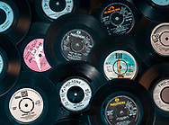 London, England - May 21, 2020: Selection of vintage vinyl 45rpm singles showing different record labels, The 7 inch single was first released in 1949 by RCA Victor.