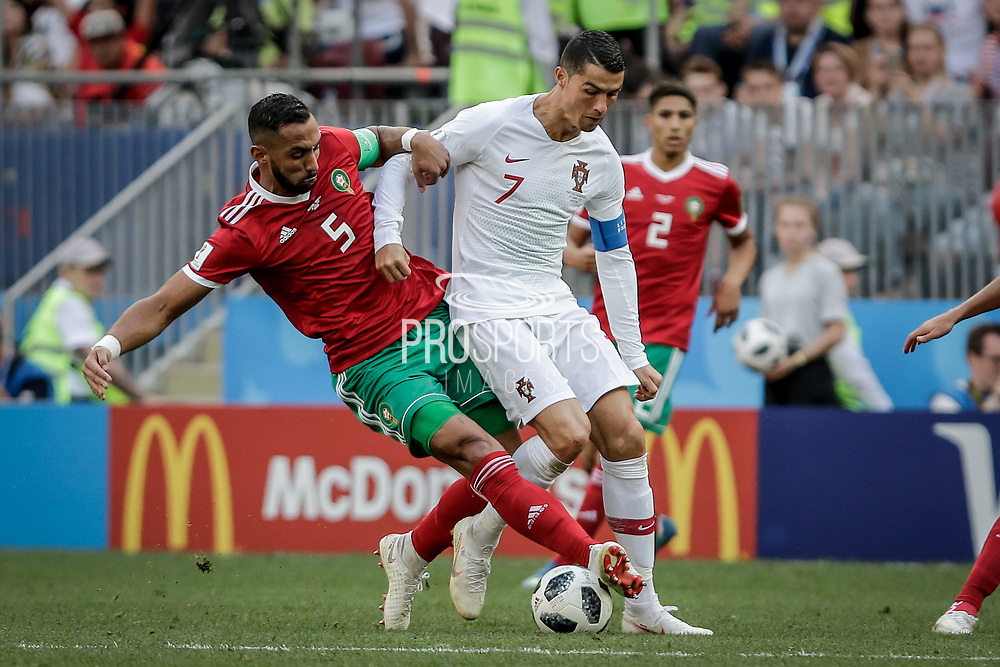 Cristiano Ronaldo of Portugal and Mehdi Benatia (L) of Morocco during the 2018 FIFA World Cup Russia, Group B football match between Portugal and Morocco on June 20, 2018 at Luzhniki stadium in Moscow, Russia - Photo Thiago Bernardes / FramePhoto / ProSportsImages / DPPI