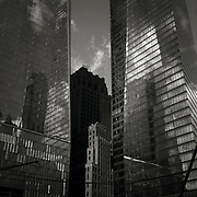The Verizon Building (formerly the Barclay-Vesey Telephone Building) designed by architect Ralph Thomas Walker is seen in partial shadow, sandwiched between World Trade 2 and World Trade 4