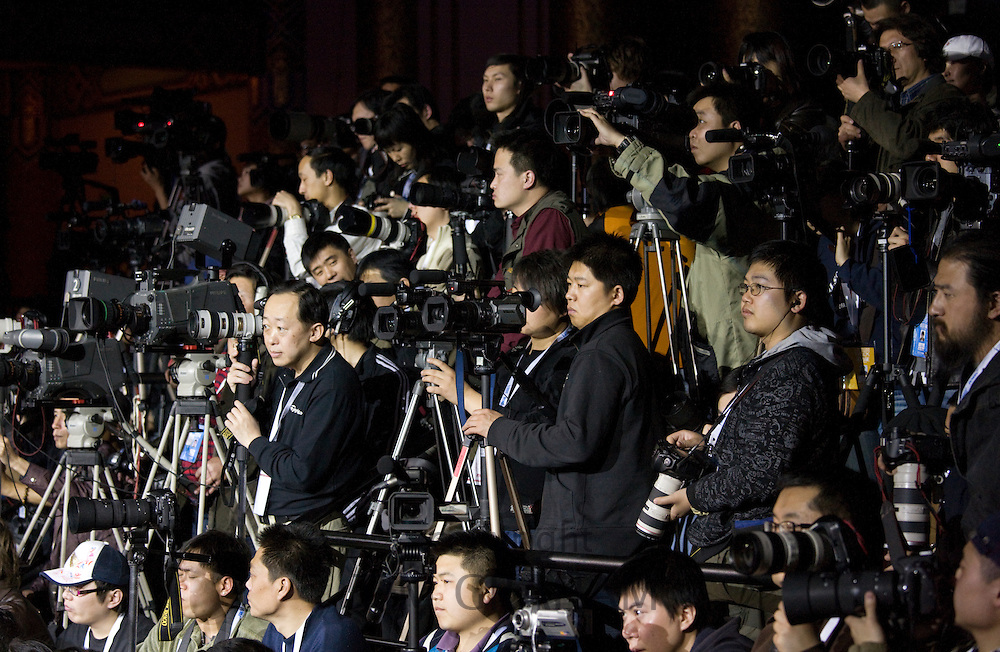 Photographers at the opening show of China Fashion Week at the Beijing Hotel, China
