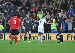 Swansea City's Neil Taylor confronts ref about red card decision  - Photo mandatory by-line: Alex James/JMP - Tel: Mobile: 07966 386802 03/11/2013 - SPORT - FOOTBALL - The Cardiff City Stadium - Cardiff - Cardiff City v Swansea City - Barclays Premier League