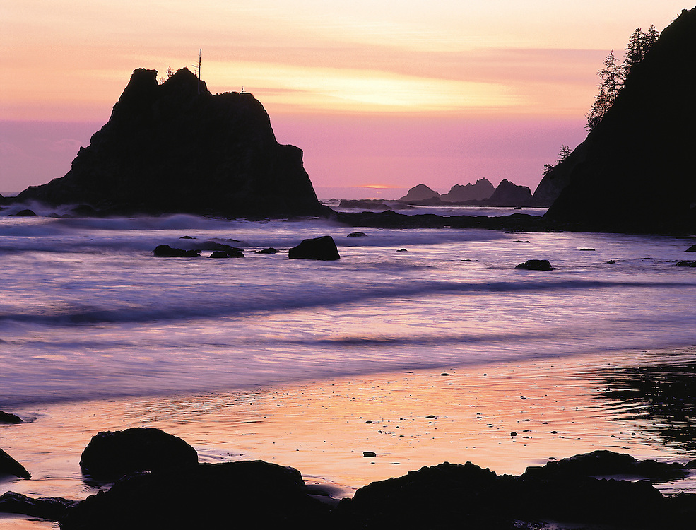 intense sunset and breaking waves on Rialto Beach, Olympic National Park, Washington State