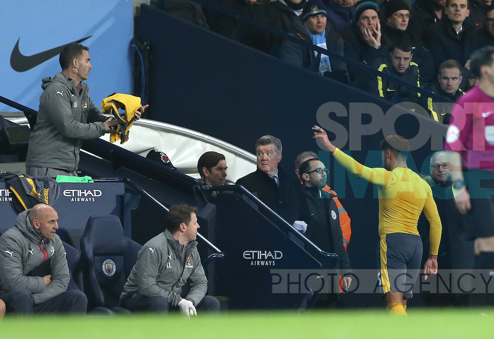 Alex Oxlade-Chamberlain of Arsenal throws his shirt to the bench as he walks off substituted during the English Premier League match at the Etihad Stadium, Manchester. Picture date: December 18th, 2016. Picture credit should read: Simon Bellis/Sportimage