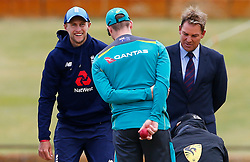 England captain Joe Root chats with Australia's Steve Smith and Shane Warne as rain halts the start of play during day five of the Ashes Test match at the WACA Ground, Perth.