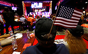 David Blair of Hendersonville, Tenn. is seen with a U.S. flag in his hat during a campaign event for Republican U.S. Representative Marsha Blackburn Sunday, Oct. 28, 2018, in Nashville, Tenn.