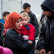 A young refugee family arrived at the Tabanovce Train Station, their stop before they cross the border into Serbia, on their way into Western Europe. abanovce, Macedonia, January 2016.