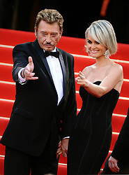 """File photo : """"Johnny Hallyday and Laeticia Hallyday attend the screening of """"""""Vengeance"""""""" at the 62nd Cannes Film Festival. Cannes, France, May 17, 2009. France's biggest rock star Johnny Hallyday has died from lung cancer, his wife says. He was 74. The singer - real name Jean-Philippe Smet - sold about 100 million records and starred in a number of films. Photo by Lionel Hahn/ABACAPRESS.COM"""""""