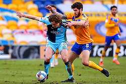 Joe Ironside of Cambridge United and Ryan Sweeney of Mansfield Town tussle for possession - Mandatory by-line: Ryan Crockett/JMP - 20/02/2021 - FOOTBALL - One Call Stadium - Mansfield, England - Mansfield Town v Cambridge United - Sky Bet League Two