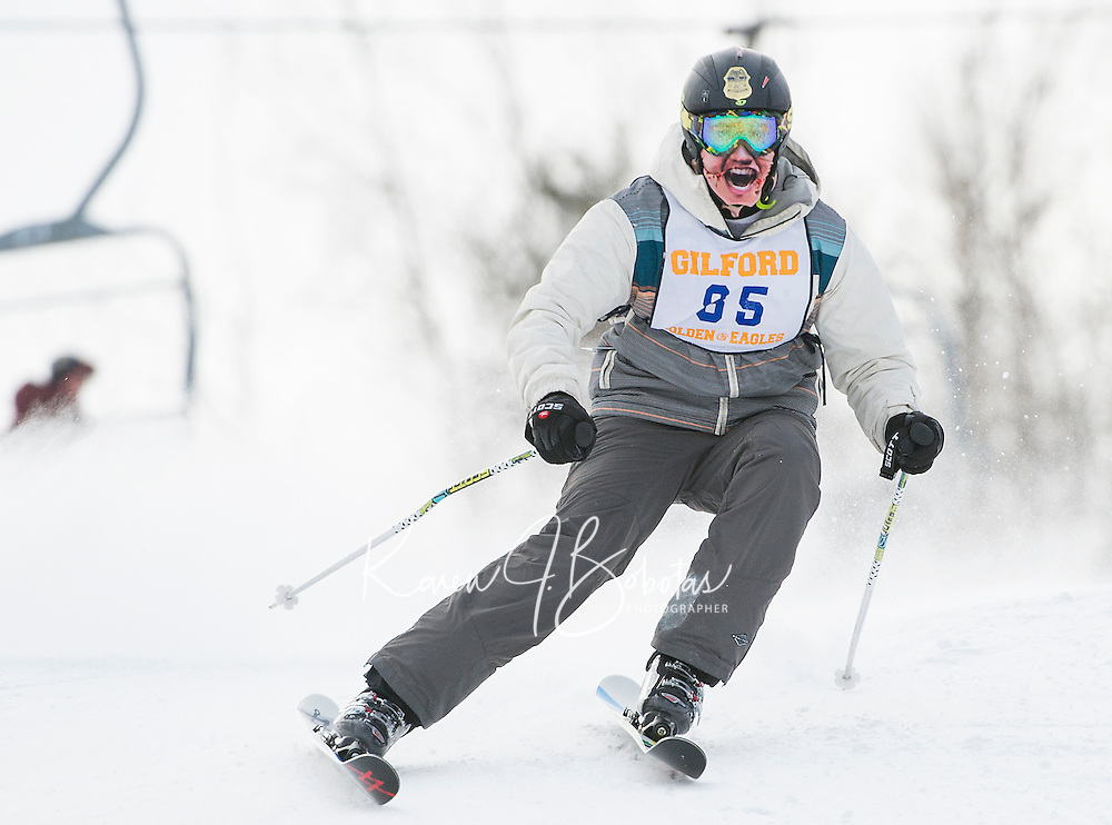 A masked Bradley Bergman on the giant slalom course for Gilford High School during the Division III alpine race at Gunstock on Friday morning.  (Karen Bobotas/for the Laconia Daily Sun)