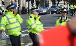 © Licensed to London News Pictures. 04/09/2019. London, UK. A heavy police presence as a car carrying British Prime Minster Boris Johnson arrives at the Houses of Parliament in Westminster, London. British Prime Minister Boris Johnson has a called for a general election after losing his first commons vote and losing his majority, removing his control of parliament. Photo credit: Ben Cawthra/LNP