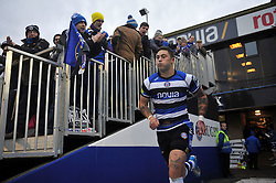 Matt Banahan (Bath) leads the team out onto the field to mark his 150th appearance for Bath Rugby - Photo mandatory by-line: Patrick Khachfe/JMP - Tel: Mobile: 07966 386802 14/12/2013 - SPORT - RUGBY UNION -  The Recreation Ground, Bath - Bath v Mogliano - Amlin Challenge Cup.