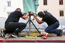 After two months of restoration, the Statue of Archangel Michael, made of copper plate, returned to Piran. The image shows the workers of Gnom working on the statue before helicopter placing it on top of the church's clock, on October 15, 2018 in Piran, Slovenia. Photo by Matic Klansek Velej / Sportida