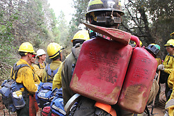 July 30, 2018 - California, U.S. - Hotshots gasoline for backfire. The Ferguson Fire now in its 20th day, started July 13 on the Sierra National Forest. The fire is now 62,883 acres with 39 percent containment and 3,558 personnel that are currently engaged on the fire which include 203 engines, 43 water tenders, 14 helicopters, 95 crews, 5 masticators and 62 dozers. There has been 2 fatalities and 9 injuries to date. 1 structure has been destroyed. (Credit Image: © Rubicon/Cal Fire via ZUMA Wire/ZUMAPRESS.com) (Credit Image: © Rubicon/Cal Fire via ZUMA Wire/ZUMAPRESS.com)