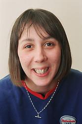 Portrait of female resident of homeless hostel smiling,