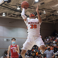 Gallup Bengal Joaquin Ortega (30) drives to the basket against the Bernalillo Spartans during their New Mexico Class 4A boys basketball quarterfinal game at Gallup High School in Gallup Tuesday. The Bengals defeated the Spartans 70-67 to advance to the semifinals.