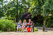 Maidenhead, Berkshire, United Kingdom, Wednesday, 02/06/2021, General View, Mature family relax on a bench, in the sunshine, Ray Mill Island,  Thames Valley, [Mandatory Credit; Pete Spurrier],
