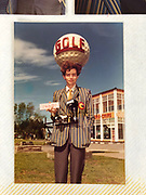 Dafydd Jones early on in the season holding a film number. Photo probably by fellow colour-walkie photographer Philip Steeples. ..Butlins, 1979