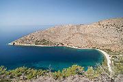 Hills overlooking sandy beach and blue sea, Elinda, Chios, Greece