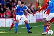 Portsmouth midfielder Gareth Evans (26) has his eye on the ball during the EFL Sky Bet League 1 match between Accrington Stanley and Portsmouth at the Fraser Eagle Stadium, Accrington, England on 27 October 2018.