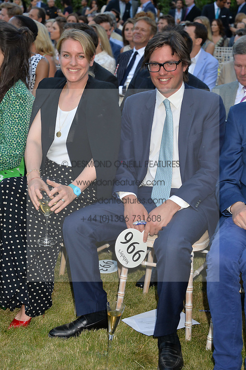HARRY LOPES and LAURA PARKER-BOWLES at the Quintessentially Foundation and Elephant Family 's 'Travels to My Elephant' Royal Rickshaw Auction presented by Selfridges and hosted by HRH The Prince of Wales and The Duchess of Cornwall held at Lancaster House, Cleveland Row, St.James's, London on 30th June 2015.