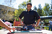 DhanKaran Ajravat admires his process with a friend during a Habitat for Humanity playhouse build at the SanDisk headquarters in Milpitas, California, on August 27, 2013. (Stan Olszewski/SOSKIphoto)
