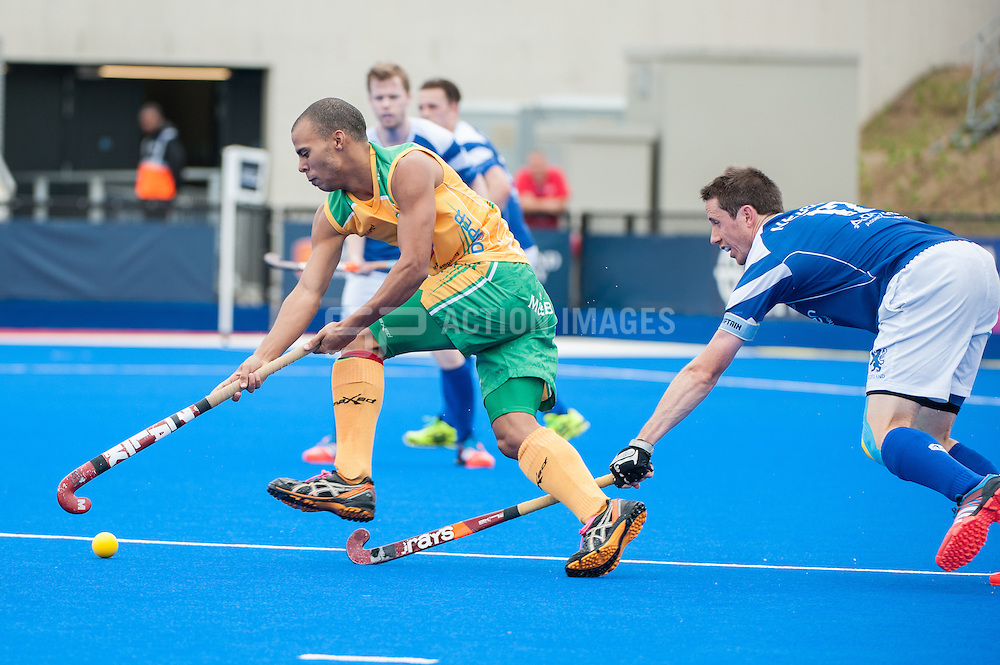 Ignatius Malgraff (RSA) is shadowed by Chris Nelson (SCO). Scotland v South Africa, 3rd/4th play-off, Investec London Cup, Lee Valley Hockey & Tennis Centre, London, UK on 13 July 2014. Photo: Simon Parker