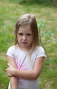 Outdoor portrait of a solum young French girl age 8. Zawady Central Poland