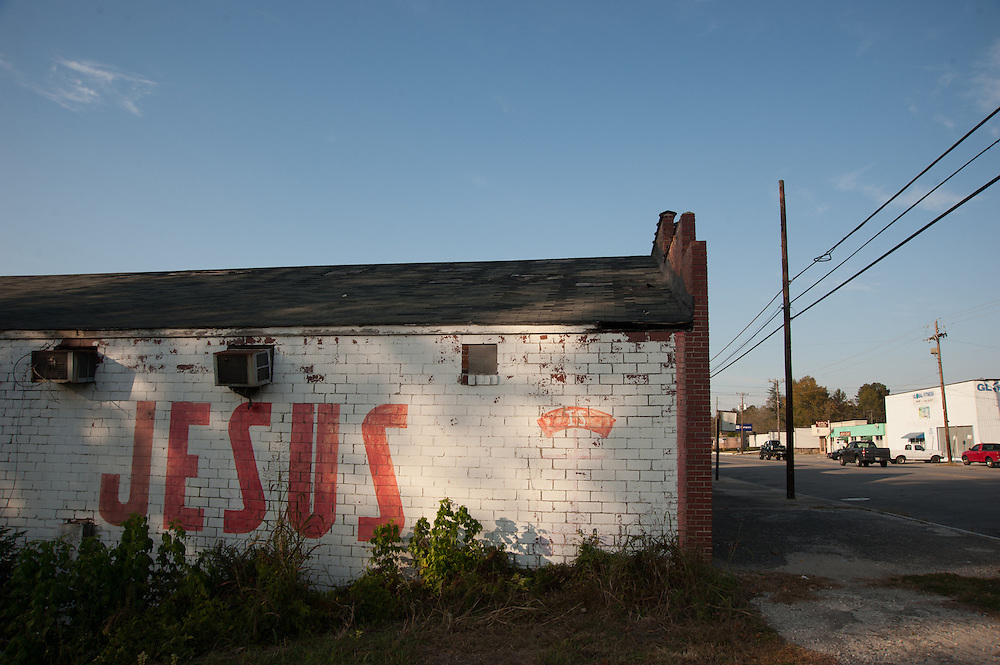 """""""Jesus"""" painted on the side of a building in a small Alabama town."""