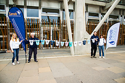 Pictured: Angie Alexander, Marion and Ian Currie and Nicola Wash hold up a washing-line with babygrows to highlight the launch<br /> <br /> Stillbirth and neonatal death charity  launched their awareness month campaign today in Edinburgh. The #15babiesaday drive by Sands aims to highlight the fact 15 babies a day in the UK die shortly before, during or after birth.  MSPs Neil Findlay, Kezia Dugdale, Angela Constance, Ian Gray among others joined bereaved parents at its Scottish Parliament launch today.<br /> <br /> Ger Harley | EEm 15 June 2017