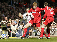 Photo: Aidan Ellis.<br /> Liverpool v Bolton Wanderers. The Barclays Premiership. 09/04/2006.<br /> Liverpool's Johna Arne Riise nicks the ball away from Bolton's Stellios
