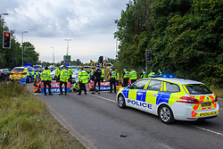 © Licensed to London News Pictures. 13/09/2021. Hertfordshire, UK. Protesters from climate campaign 'Insulate Britain', an offshoot of Extinction Rebellion (XR), block the A41 roundabout at Junction 20 of the M25 London Orbital Motorway. Photo credit: Peter Manning/LNP