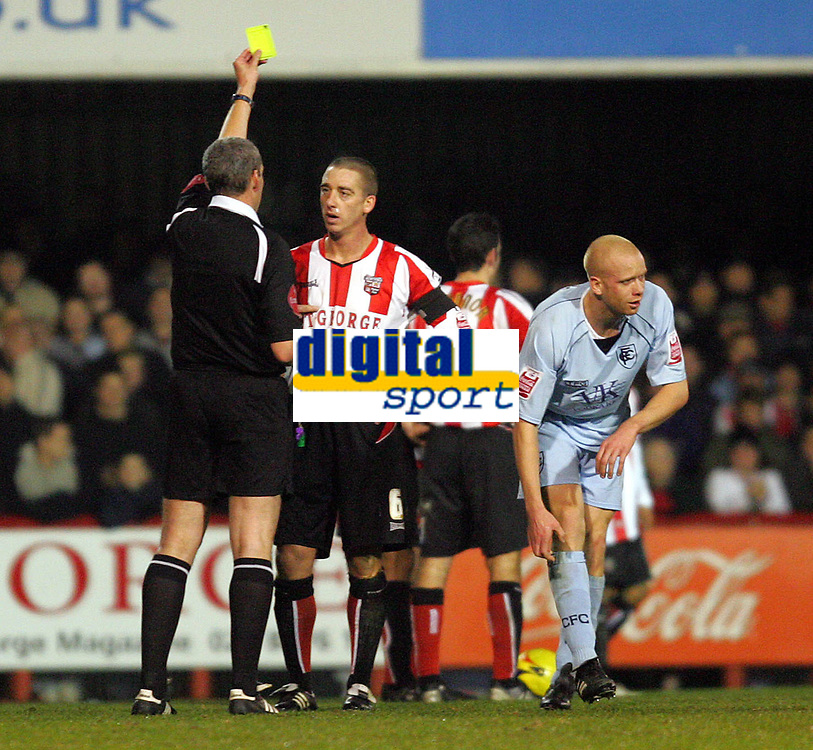 Photo: Frances Leader.<br />Brentford v Chesterfield. Coca Cola League 1. <br />10/12/2005.<br />Brentfords' captain Ricky Newman (2nd, L) gets a yellow card with Chesterfield's Derek Niven (R) for having a fight on the pitch.