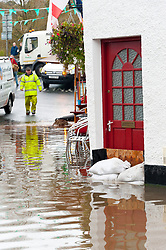 © Licensed to London News Pictures. 26/10/2019. Crickhowell, Powys, Wales, UK. residents of Bridege St in Crichowell, Powys get sandbags as rain falls relentlessly and the level of the river Usk rises dramatically. Water enters The Bridge End Inn basement in Bridge Street, Crickhowell  in Powys. Photo credit: Graham M. Lawrence/LNP