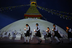 April 25, 2017 - Kathmandu, Nepal - Nepalese school students hold candles taking rounds around the Boudhanath Stupa in remembrance and memory of those lives lost to mark the 2nd anniversary of the 2015 Nepal Earthquake in Kathmandu. (Credit Image: © Skanda Gautam via ZUMA Wire)