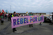 Activists from Extinction Rebellion perform an Eco action on New Years day on 1st January 2020 in St Ives, United Kingdom. Dressed in disco fancy dress, flares, afro's and general disco outfits the group danced through the streets of St Ives with their dance moves to Staying Alive making it a fun way to highlight the issues of climate change. They did a flash mob in the infamous local pub The Three Ferrets. The action lasted for two hours and they picked up new followers along the way.