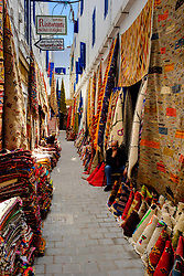 Stalls selling carpets and rugs in the narrow streets of the medina, Essaouira, Morocco<br /> <br /> (c) Andrew Wilson | Edinburgh Elite media