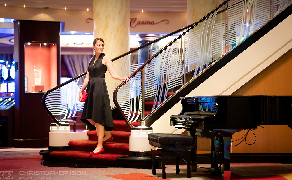 Debs Stubbington from Bang on Style in the Grand Lobby on formal night on board Cunard's luxury ocean liner Queen Mary 2 during Transatlantic Fashion Week. 2017. <br /> Date: Friday September 1; 2017.<br /> For the second year running, the Transatlantic Fashion Week will bring together some of the most reputable names within the fashion industry to host seven days of runway shows, inspiring talks, glamorous dinners and exclusive unveilings. The crossing will leave Southampton tomorrow, 31st August arriving in to New York on the 7th September the very same day as New York Fashion Week 2017 begins.<br /> <br /> Photograph by Christopher Ison © for Cunard.<br /> 07544044177<br /> chris@christopherison.com<br /> www.christopherison.com