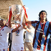 Jubilant Trabzonspor players Alan Carlos Gomes Da COSTA (L), Gustavo COLMAN (R) lifting up the cup at the ceremony during their after the Turkey Cup final match Trabzonspor between Fenerbahce at the GAP Arena Stadium at Urfa Turkey on wednesday, 05 May 2010. Photo by TURKPIX