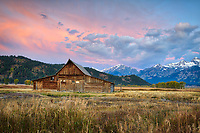 A barn along Mormon Row in Grand Teton National Park, Wyoming at sunrise in the fall.