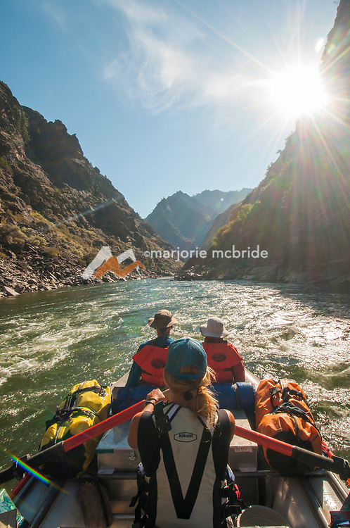 Morning surise sprays over peaks in The Impassible Canyon on the Middle Fork of the Salmon River during six day rafting vacation, Idaho.