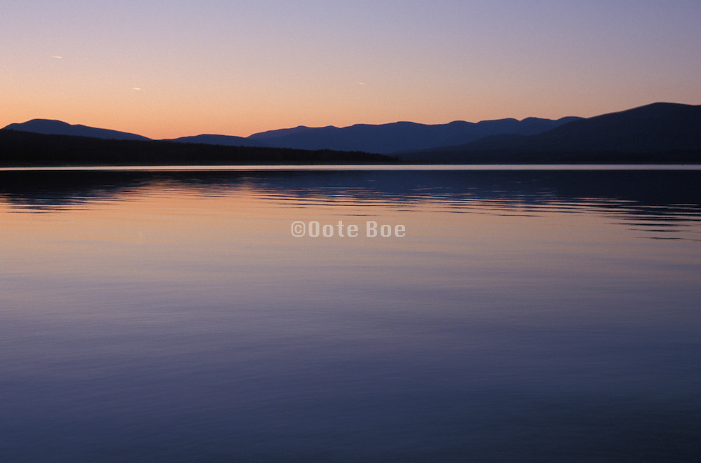 Tranquil view of lake and mountains