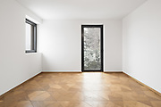 Empty room with window. It's snowing outside