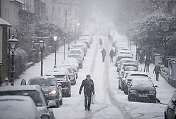 © Licensed to London News Pictures. 24/01/2021. London, UK. A street blanketed white during heavy Snowfall on Hampstead Heath in Hampstead in north London. Parts of the UK continue to suffer from flooding caused by Storm Christoph. Photo credit: Ben Cawthra/LNP