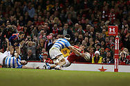 Liam Williams of Wales stretches over to 'score' a first half try but sees it disallowed. Under Armour 2016 series international rugby, Wales v Argentina at the Principality Stadium in Cardiff , South Wales on Saturday 12th November 2016. pic by Andrew Orchard, Andrew Orchard sports photography