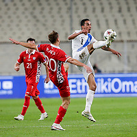 ATHENS, GREECE - OCTOBER 11: Carlos Zecaof Greece and Sergiu Platicaof Moldova during the UEFA Nations League group stage match between Greece and Moldova at OACA Spyros Louis on October 11, 2020 in Athens, Greece. (Photo by MB Media)