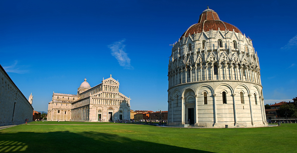 The Duomo & Leaning Tower of Pisa, Italy . The Pisa Baptistery of St. John is a Roman Catholic ecclesiastical building in Pisa, Italy. Construction started in 1152 to replace an older baptistery, and when it was completed in 1363, it became the second building, in chronological order, in the Piazza dei Miracoli, near the Duomo di Pisa . The largest baptistery in Italy, it is 54.86 m high, with a diameter of 34.13 m. The Pisa Baptistery is an example of the transition from the Romanesque style to the Gothic style: the lower section is in the Romanesque style, with rounded arches, while the upper sections are in the Gothic style, with pointed arches. The Baptistery is constructed of marble, as is common in Italian architecture.
