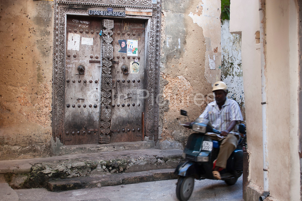 Stone Town, the main town on Zanzibar is famous for its beautiful old carved wood doors on 6th December 2008 in Zanzibar, Tanzania. Originally the size of the door would speak of the owners status or wealth. Zanzibar is a small island just off the coast of the Tanzanian mainland in the Indian Ocean. In part due to its name, Zanzibar is a travel destination of mystical reputation, known for its incredible sealife on its many reefs, the powder white coral sand beaches and the traditional cultivation of spices.