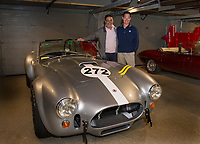 Nick Grewal gives Chris Emond a tour of his extensive race car collection including this 1968 AC Cobra on Thursday afternoon.  Grewal's collection will be on display for a fundraising event in July for the Boys and Girls club.   (Karen Bobotas/for the Laconia Daily Sun)